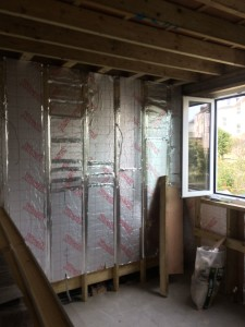The insualted walls are 35% better performing than Building Regulations requires